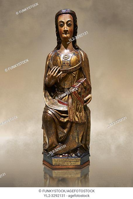 Gothic wood statue of a Saint by the St Bertrand de Cominges Group of artists. Polychrome wood carving with varnished metal-plating