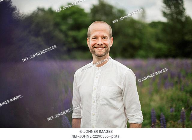 Portrait of smiling man on meadow