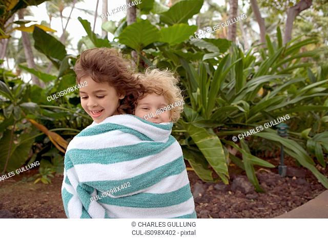 Boy and girl wrapped in towel