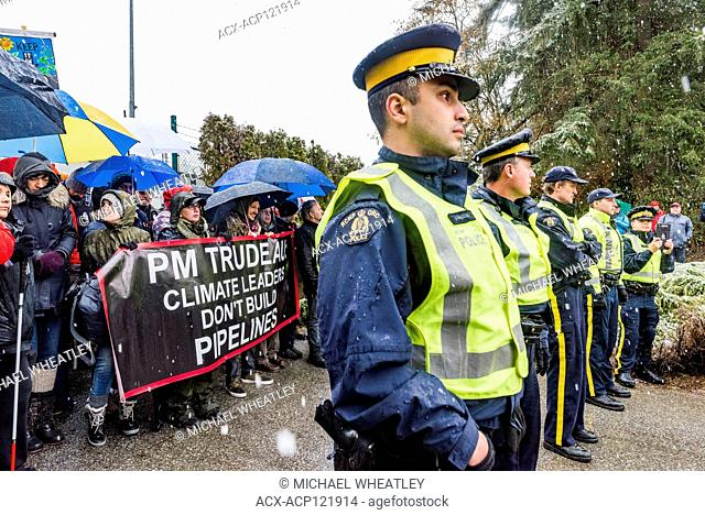 Protesters brave snow and sleet and await arrest by RCMP officers for blockading entrance to Kinder Morgan Trans Mountain Pipeline and Tank Farm on Burnaby...
