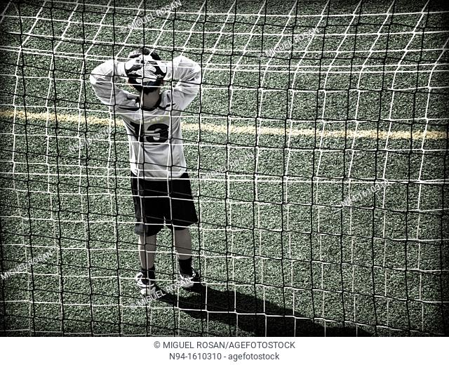 Soccer goalie during a game in a child meeting