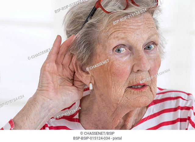 Senior woman with hearing disorders