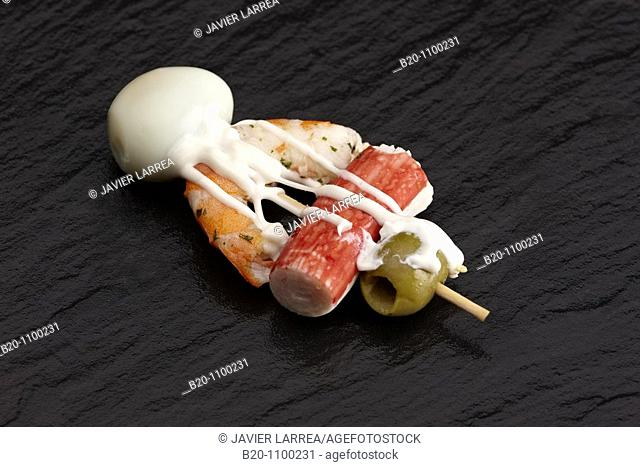 'Pintxo' of chatka, shrimp, quail egg and olive, Barakaldo, Bizkaia, Basque Country, Spain