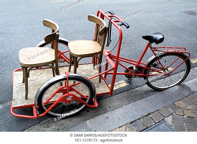 Two chairs on a red rickshaw, Old Bordeaux City, France