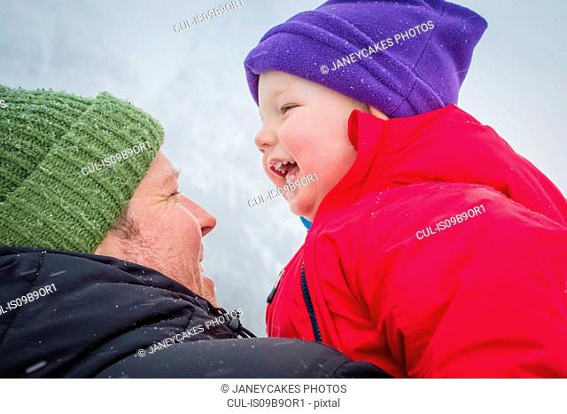Father and son in wintry weather