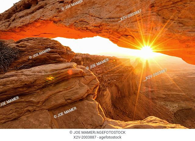 View under Mesa Arch in Canyonlands National Park at sunrise