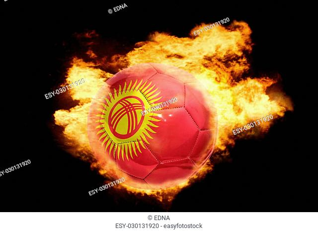 football ball with the national flag of kyrgyzstan on fire on a black background