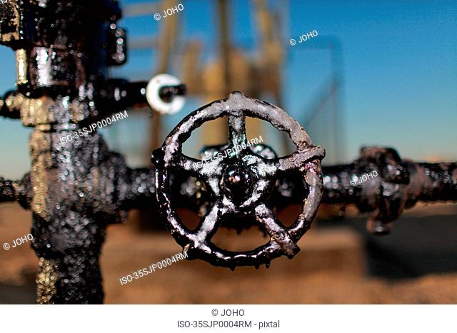 Close up of grimy wheel at oil field