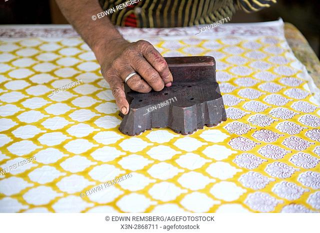 Jaipur, India - Indian man stamping pattern on fabric