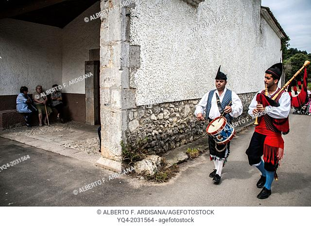 Pipers coming to the chapel of Our Lady of the Snows. Llanes. Asturias. Spain