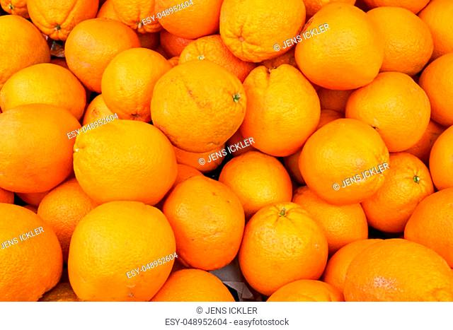 Pile of ripe oranges for sale at a market