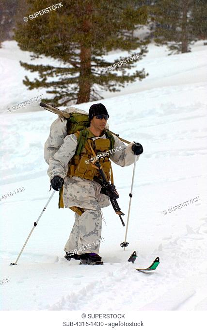US Marine Sniper Skis Toward Base Camp as a Winter Blizzard Approaches