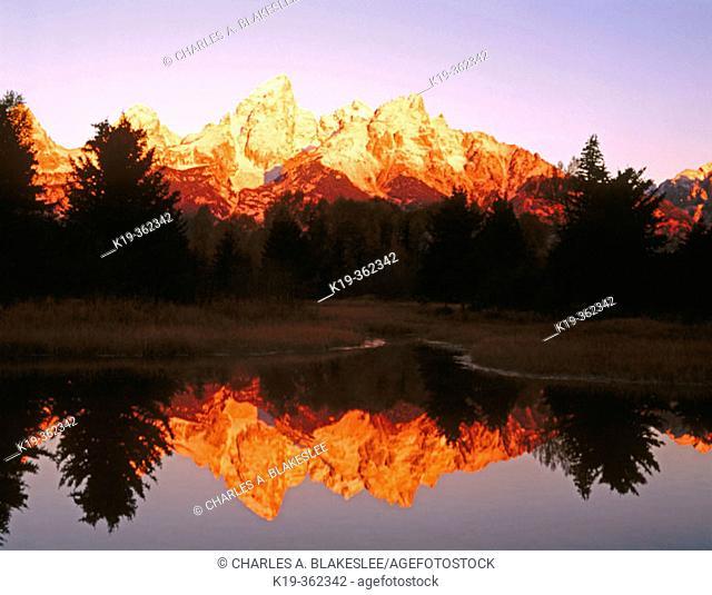 Sunrise on the Tetons from Schwabacher Landing. Snake River. Grand Teton National Park. Teton County, Wyoming. USA