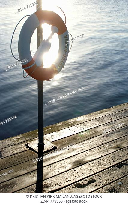Lifbuoy at public jetty. The Baltic Sea