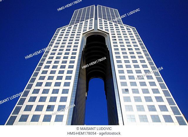 United Arab Emirates, Dubai, modern building on Sheikh Zayed Road hosting Dusit Thani Dubai Hotel
