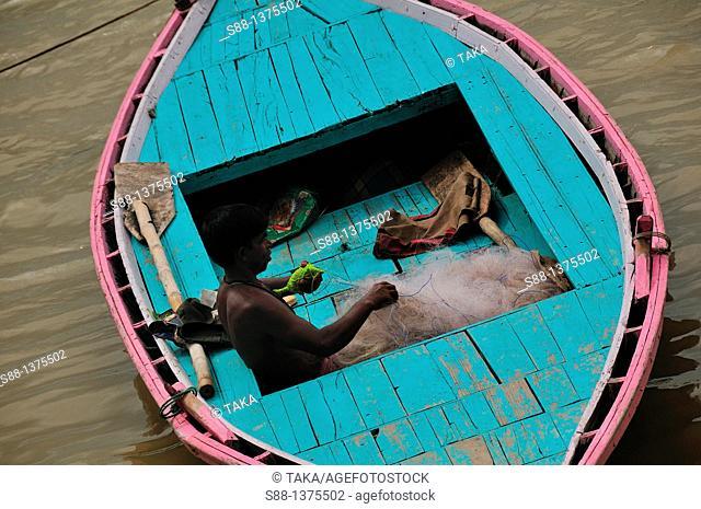 Fisherman preparing fishing net at Holly Ganges River