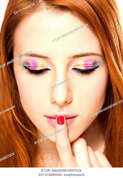 Close-up portrait of redhead girl with make-up