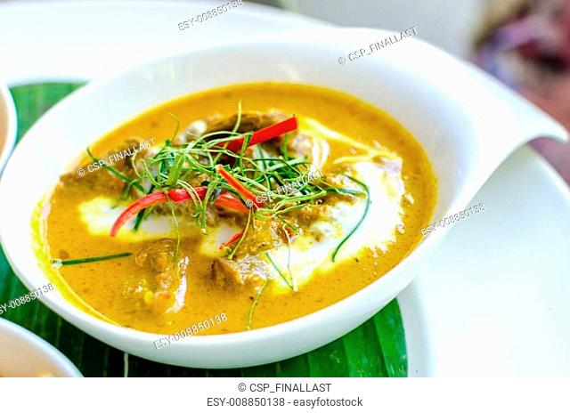 Red curry paste with sliced beef and coconut milk