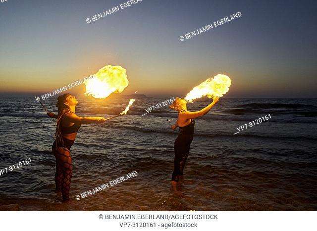 fire-breathing , beach, standing in sea water, in holiday destination Chersonissos, Crete, Greece