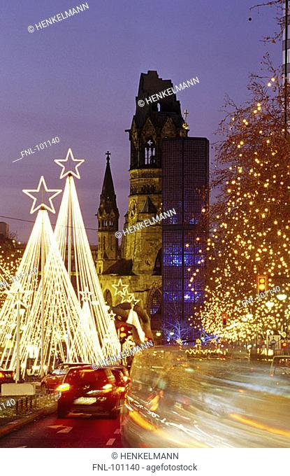 Trees lit up with Christmas lights along road at night, Berlin, Germany