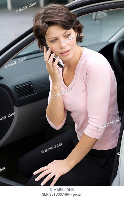 Businesswoman on cell phone in car