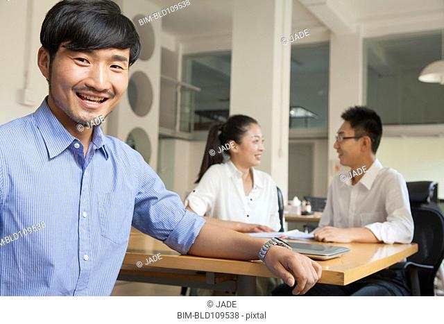 Chinese businessman sitting at conference table