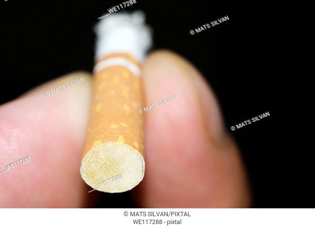 Holding a cigarette