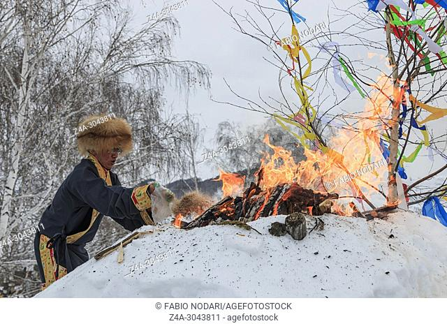 Tuva people, one of the minorities in China, performing a religious rite in Hemu village