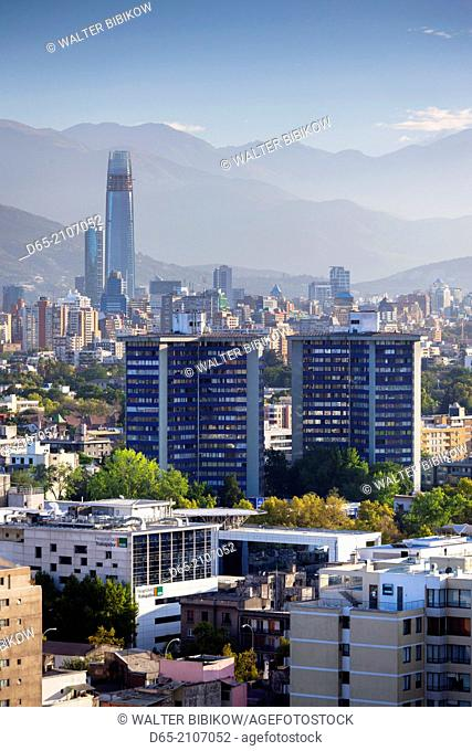 Chile, Santiago, elevated city view towards the Gran Torre Santiago tower, dawn