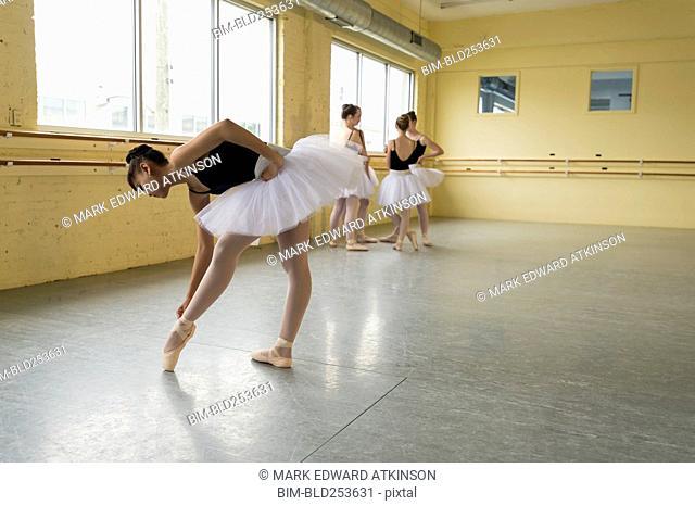 Girl checking shoe in ballet studio