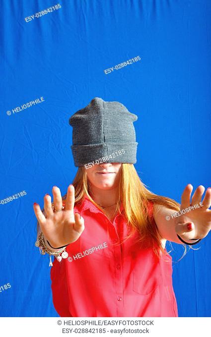 Teen hiding his face with his bonnet