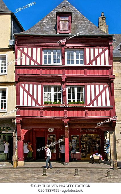 Shops and red half timbered house,Cordeliers square, Dinan, Cotes d'Armor 22, Brittany, France