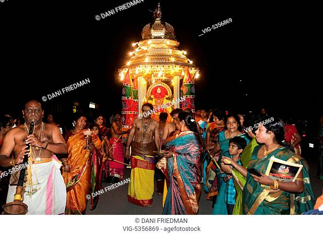 CANADA, BRAMPTON, 03.08.2015, Tamil Hindu devotees escort and pull the chariot carrying the Vel idol during the Aadivel Festival (Aadi Vel Festival) at the Sri...