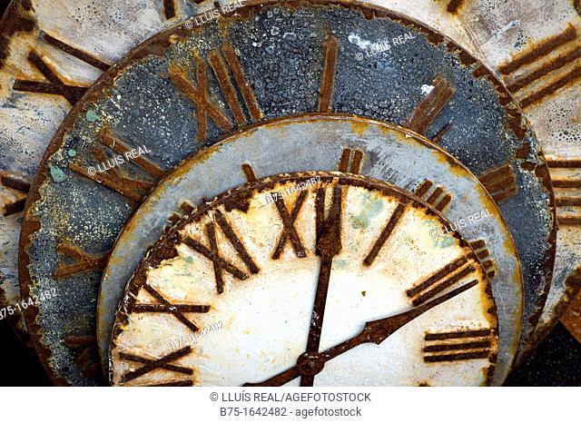 rusty old watch dials in a market of second hand items