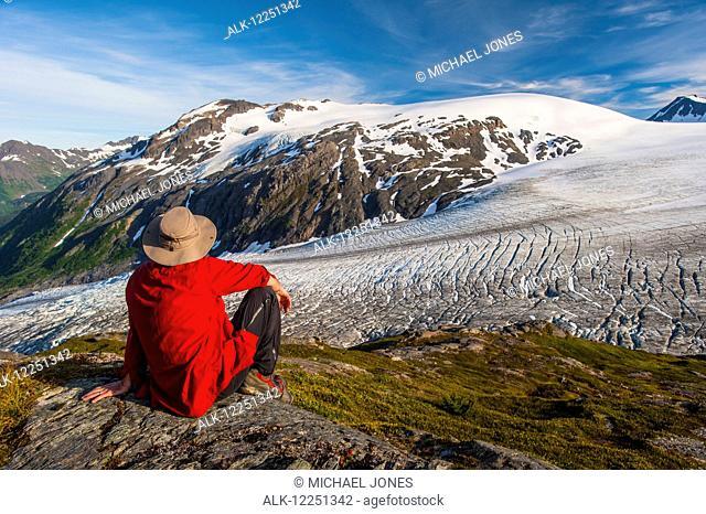 Man enjoys the view over Exit Glacier, Kenai Fjords National Park, Kenai Peninsula, Southcentral Alaska