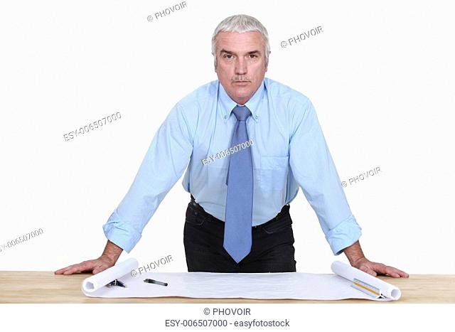 Middle-aged architect looking at plans