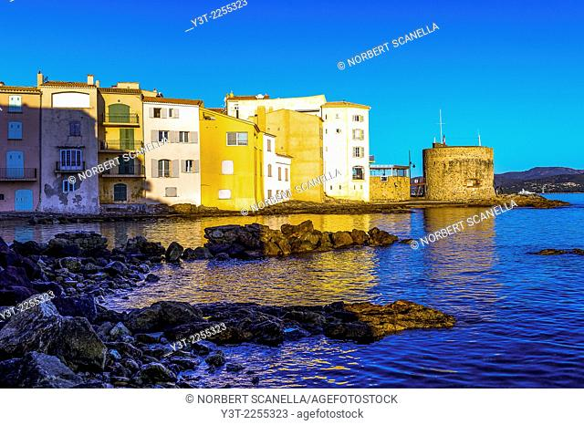 Europe, France, Var, Saint-Tropez. Colored houses in the Ponche beach and the Tower Portalet XV century in the early morning