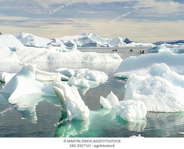 Icebergs in the Uummannaq Fjord System, fishing boat between icebergs. America, North America, Greenland, Denmark