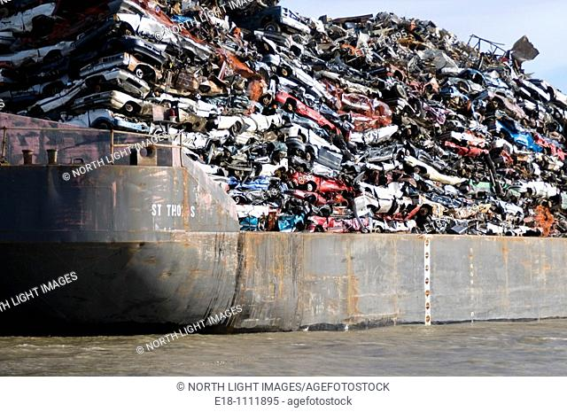 Canada, BC, Barge loaded up with flattened automobiles  Going to scrap metal recycling yard