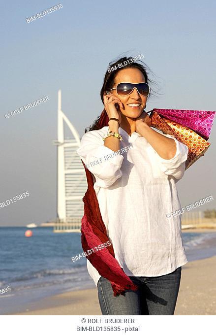 Middle Eastern woman smiling on beach, Dubai, United Arab Emirates