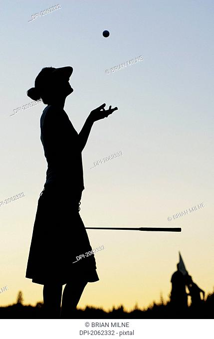 Silhouette Of Young Woman On Organic Golf Course, Clear Lake Golf Course, Riding Mountain National Park, Manitoba, Canada