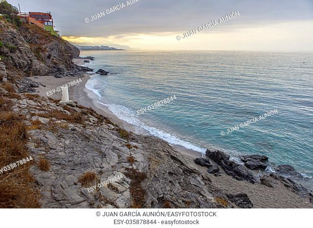 Wilches Beach, Torrox Coast, Malaga, Spain. Visible Nerja Town at bottom