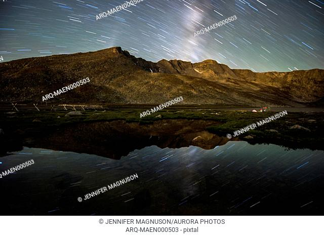 Star trails reflecting in Summit Lake at Mt. Evans in Colorado, USA
