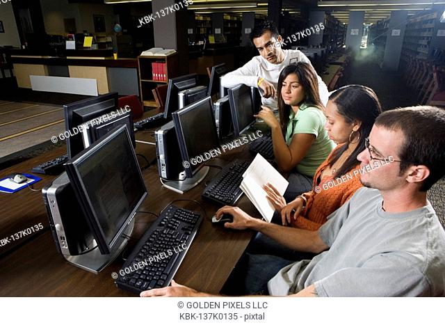 Young students using computers in the library