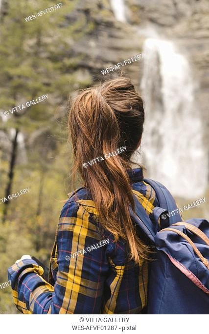 Spain, Ordesa y Monte Perdido National Park, back view of woman with ponytail looking at view