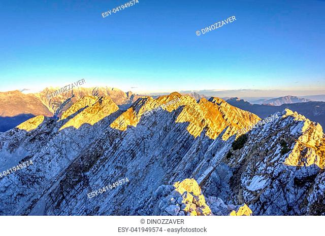 Rocky mountains in the italian alps in afternoon sun