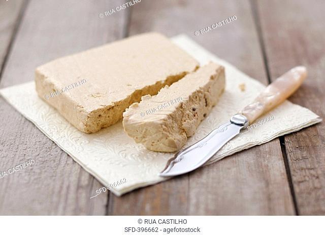 Vanilla halva on a napkin with knife