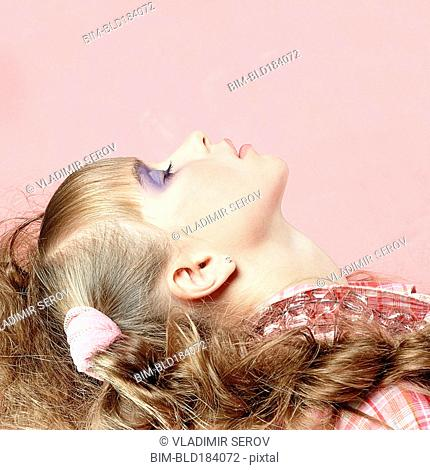 Profile of Caucasian girl wearing makeup