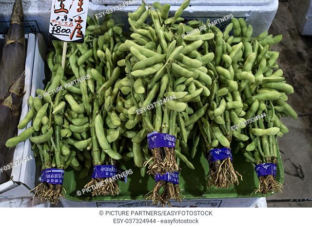 Fresh bunches of green edamame, immature soybeans in the pod, at the Omicho Market