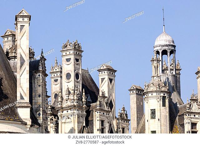 The beautiful masonary of the Chateau de Chambord. Some of the 365 chimneys can be seen adorning the roof